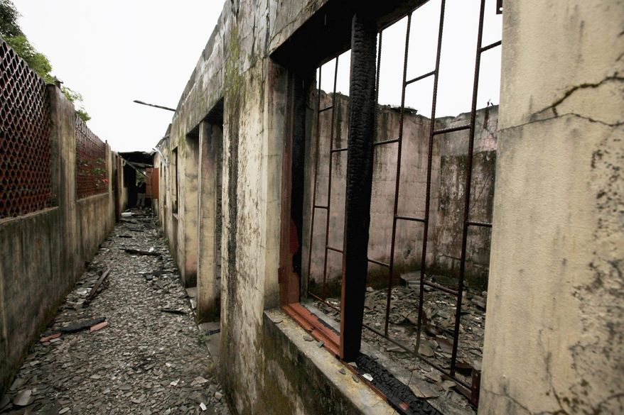 Crumbling masonry and metal and charred wood are all that remain of a former prison known as Tekunle. The prison was built in dense jungle that engulfs this island outside of Nigeria's largest city. It never officially existed, although many critics of the nation's military rule were kept here. (Associated Press)