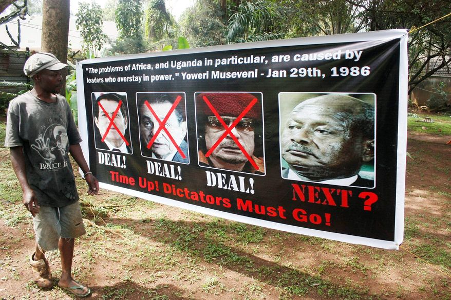 A member of Uganda's opposition ties up a banner in Uganda's capital Kampala Thursday, Sept. 8, 2011, showing former long serving presidents, left to right, Ben Ali (Tunisia), Hosni Mubarak (Egypt), Moummar Gaddafi (Libya) and current Ugandan president Yoweri Museveni in preparation for celebrations for the downfall of these leaders, in Kampala on Friday. Uganda Police has warned that they will arrest whoever turns up for the celebrations. Other long serving African leaders are Mbasago of Equatorial Guinea (32 years since 1979), Jose Santos of Angola (32 years since 1979), Robert Mugabe of Zimbabwe (31 years since 1980), Paul Biya of Cameroon (29 years since 1982), Blaise Campore of Burkina Fasso ( 24 years since 1987), Mswati III of Swaziland (24 years since April 1986), Omar Bashir of Sudan ( 21 years since 1989), Idrissu Deby of Chad ( 21 years since 1990), Isaias Afewerki of Eritrea ( 18 years since 1993), Yahya Jammeh of Gambia (17 years since 1994) , Meles Zenawi of Ethiopia (16 years since 1995) , Pakalitha Mosisili of Lesotho (13 years since 1998), Ismail Omar Guelleh of Djibouti ( 12 years since 1999), Mohammed VI of Morocco (12 years since 1999), Abdoulaye Wade of Senegal ( 11 years since 2000) and Paul Kagame of Rwanda (11 years since 2000). (AP Photo / Stephen Wandera)