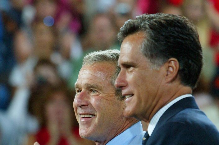 **FILE** President George W. Bush is introduced Aug. 30, 2004, by Massachusetts Gov. Mitt Romney at a campaign rally in Nashua, N.H. (Associated Press)