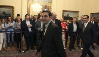 Alexis Tsipras, leader of Greece's Radical Left party, arrives for a meeting of political party leaders at the Presidential Palace in Athens on Wednesday, May 16, 2012. (AP Photo/Thanassis Stavrakis)