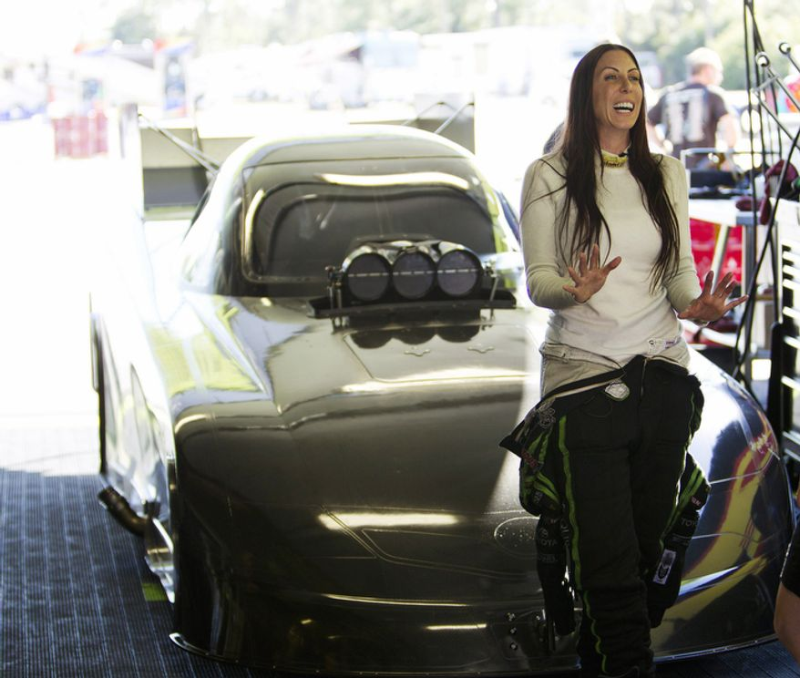 Alexis DeJoria, competitive drag racer and heiress to a billion-dollar empire, speaks Jan. 20, 2012, before a race in Juniper, Fla. (Associated Press)