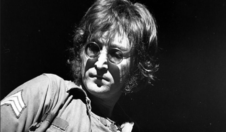 **FILE**  John Lennon performs at New York's Madison Square Garden on Aug. 30, 1972. (Associated Press)