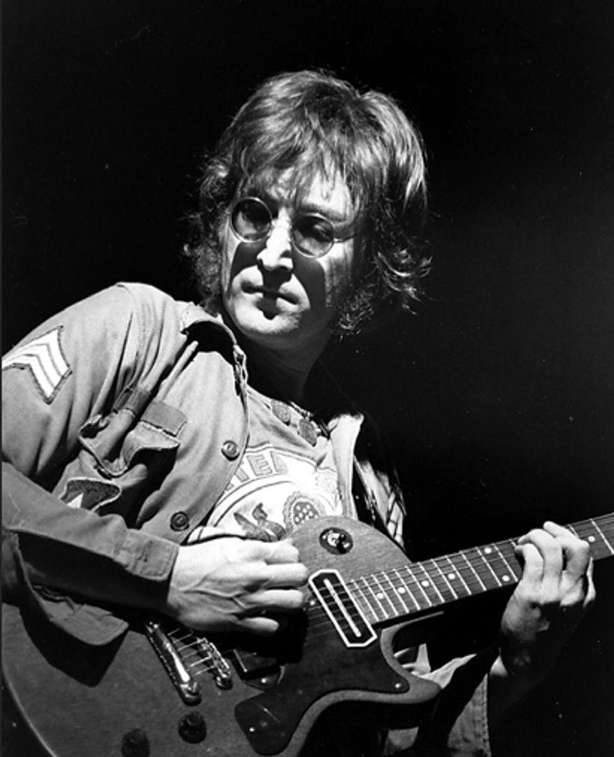 **FILE**  John Lennon performs at New York's Madison Square Garden on Aug. 30, 1972. (Associated Press)