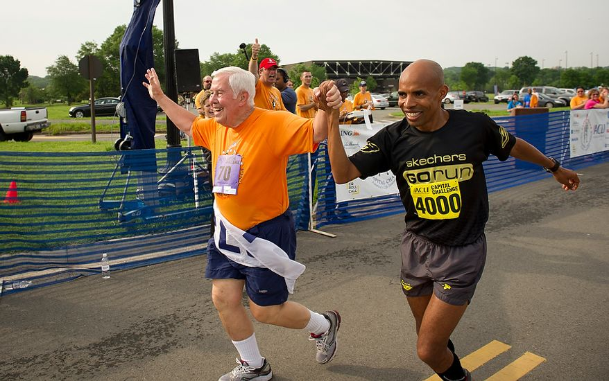 Senator Richard Lugar (R-Ind.) is joined by 2004 Olympic Silver Medalist Meb Keflezighi (#4000) as they cross the finish line together during the ACLI Capital Challenge at Anacostia Park in Washington, D.C., Wednesday, May 16, 2012. This is the 31st running of the three-mile race where members of Congress, national media outlets and locals take part in this fundraising event in the early morning hours along the water of the Anacostia River.  (Rod Lamkey Jr/The Washington Times)