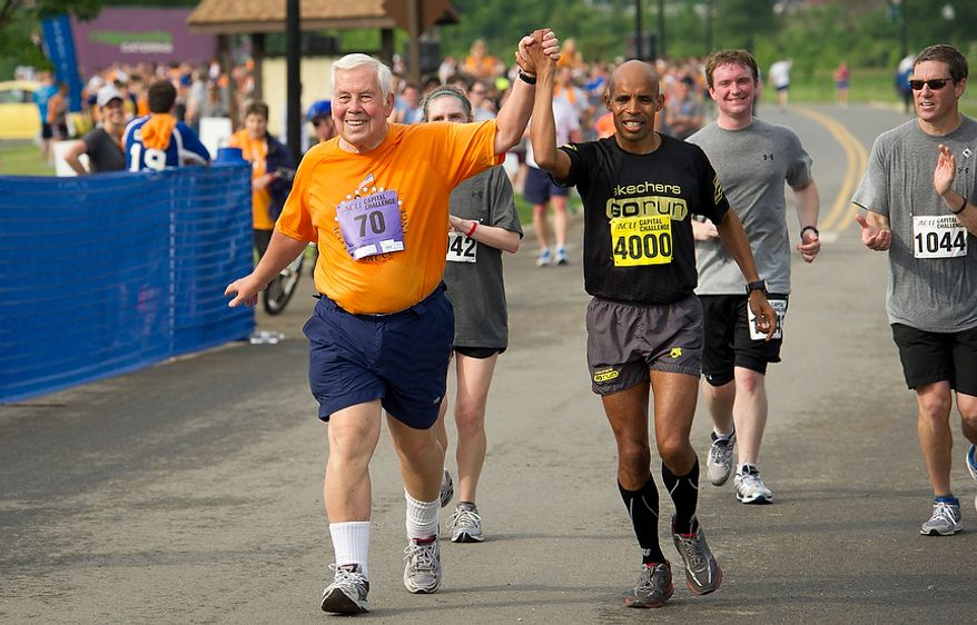 Senator Richard Lugar (R-Ind) is joined by 2004 Olympic Silver Medalist Meb Keflezighi (#4000) as they make their way to the finish line during the ACLI Capital Challenge at Anacostia Park in Washington, D.C., Wednesday, May 16, 2012. This is the 31st running of the three-mile race where members of Congress, national media outlets and locals take part in this fundraising event in the early morning hours along the water of the Anacostia River.  (Rod Lamkey Jr/The Washington Times)