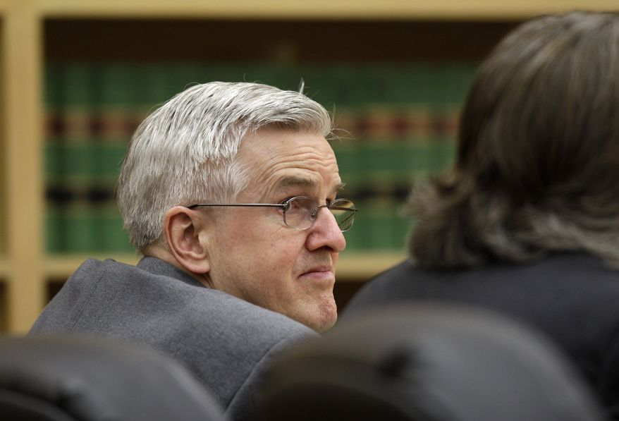 Steve Powell looks toward his attorneys during final arguments in his trial on voyeurism charges on Tuesday, May 15, 2012, in Tacoma, Wash. (AP Photo/Ted S. Warren)