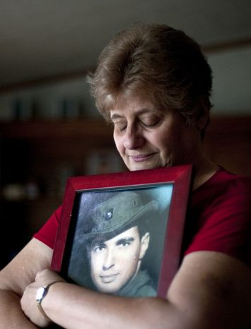 Rose Mary Sabo-Brown holds a photo of her husband, Army Spec. Leslie H. Sabo Jr., at her home in New Castle, Pa., on Thursday, May 10, 2012. (AP Photo/Andrew Russell, Tribune-Review)