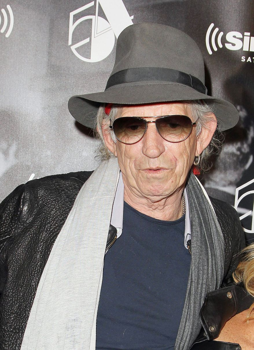 """Rolling Stones guitar man Keith Richards, 68, has stayed in the limelight with a best-selling memoir and by playing Johnny Depp's father in two """"Pirates of the Caribbean"""" sequels. (Associated Press)"""