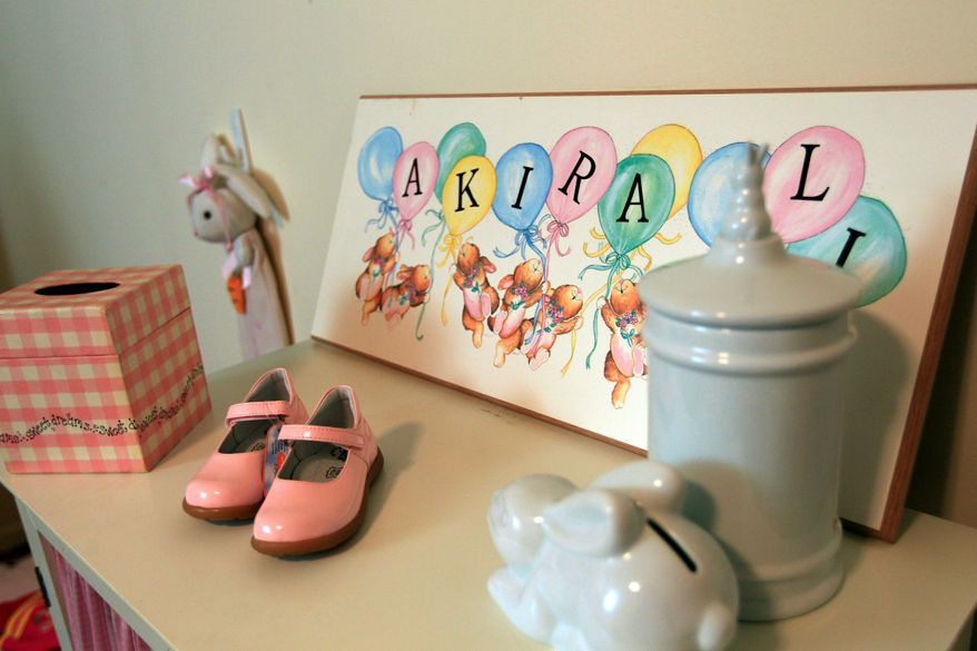 In this March 31, 2012 photo, items meant for Akira-Li, a child Sharon Brooks was planning to adopt, are shown at her house in New York. Brooks, 56, waited three and a half years for the release of a little girl in Vietnam after the U.S. froze adoptions there in 2008 amid serious fraud concerns. Finally, in January, Brooks learned the child she had named Akira-Li would instead be adopted by a Vietnamese family. (AP Photo/Frank Franklin II)