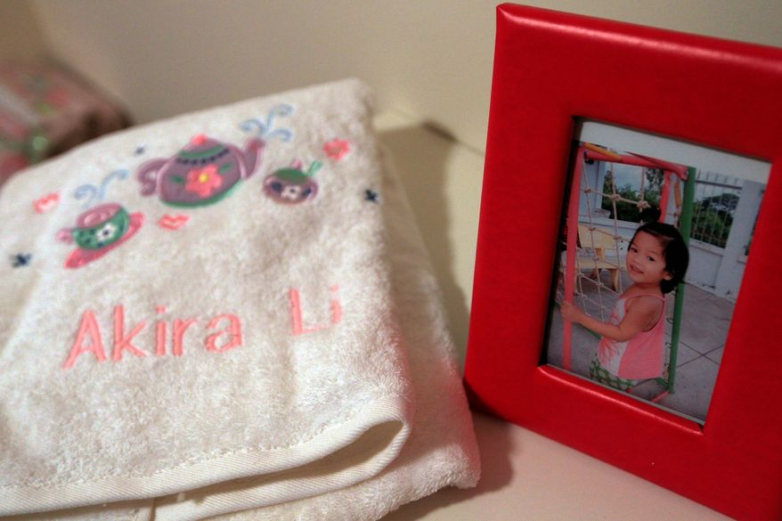 A towel with Akira-Li's name on it sits next to her picture in the New York home of Sharon Brooks, 56, who also bought other things for the child she hoped to adopt from Vietnam. But after 3 1/2 years of waiting because the U.S. froze adoptions there amid fraud concerns, Ms. Brooks (below) learned the girl would instead be adopted by a Vietnamese family. (Associated Press)