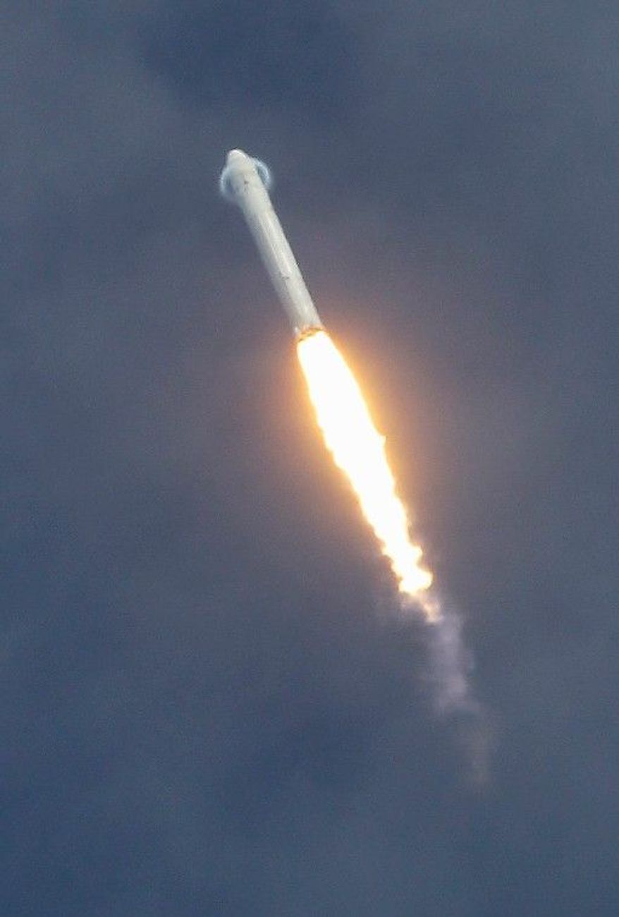 The SpaceX Falcon 9 rocket, seen after a 2010 launch, is set to head to the International Space Station on Saturday with a payload of supplies. The rocket will be unmanned. (Associated Press)