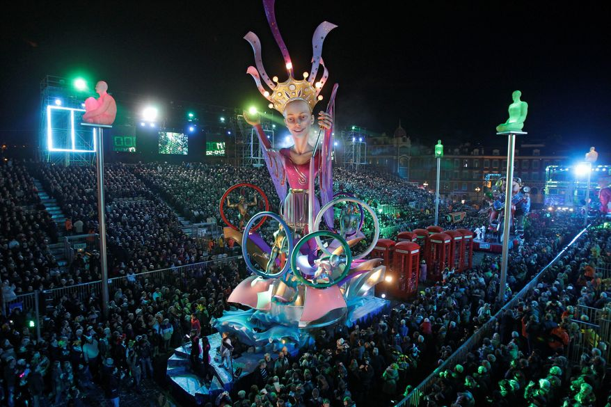 The float for the Queen of Nice Carnival 2012 parades past thousands of spectators. (Associated Press)