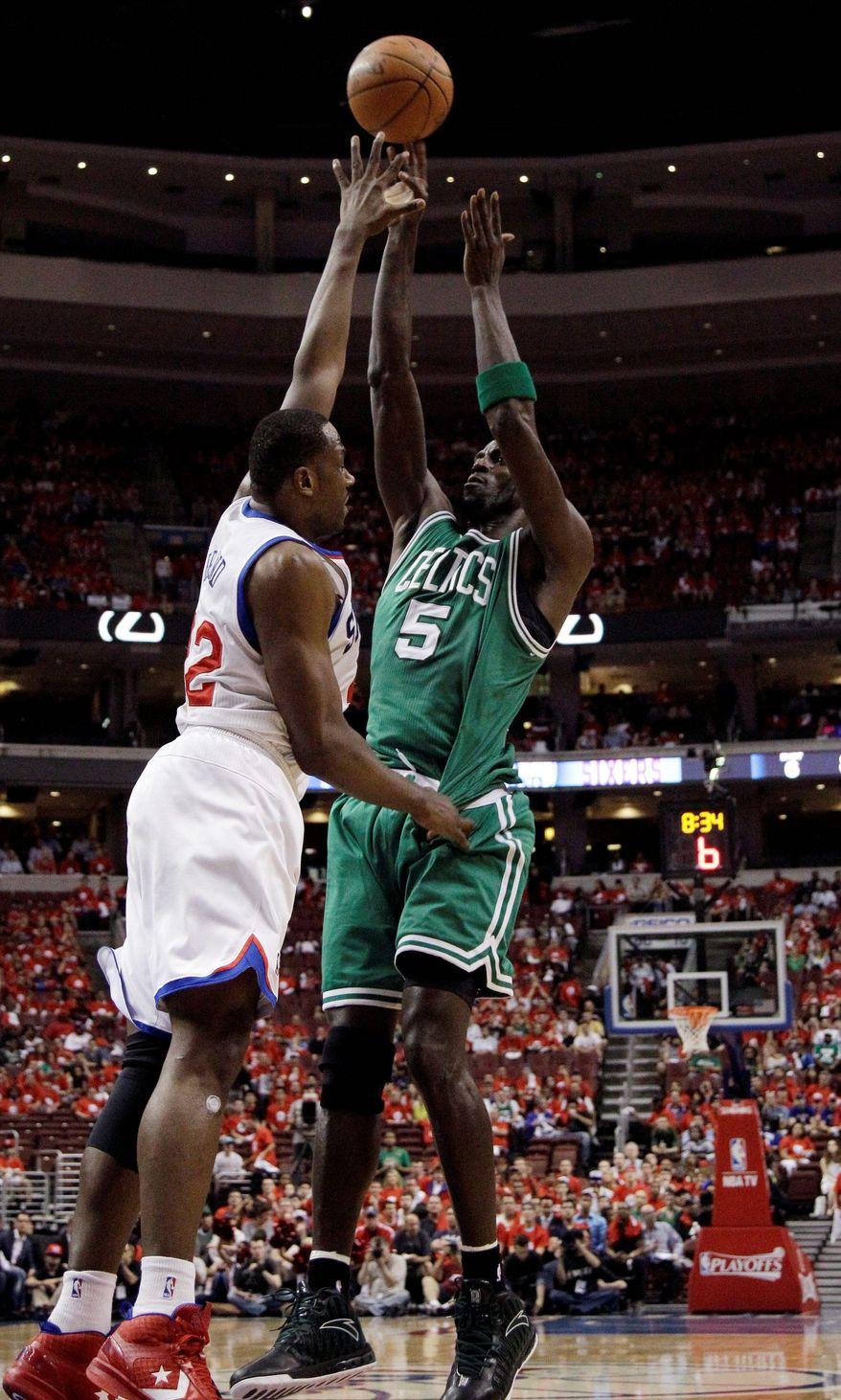 Boston's Kevin Garnett (5) shoots against Philadelphia's Elton Brand during Game 3. Garnett finished with 27 points and 13 rebounds in the Celtics' 107-91 win.