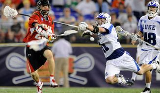 Drew Snider (left), shown against Duke last season, scored three goals during Maryland's 10-9 win over Lehigh in the NCAA tournament Sunday. (Associated Press)