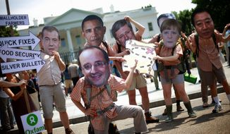 Oxfam activists wearing masks depicting Group of Eight world leaders participate in a demonstration outside the White House on Thursday. President Obama will welcome G-8 leaders to his presidential retreat at Camp David in Maryland. (Associated Press)
