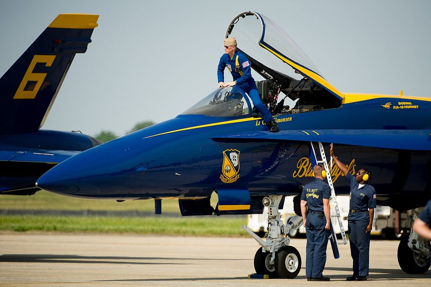 Lt. C.J. Simonsen steps out of his aircraft after the U.S. Navy's Blue Angels flight demonstration squadron returns from an afternoon practice in preparation for the 2012 Joint Service Open House and Air Show to be held at Andrews Air Force Base Saturday May 19th and Sunday May 20th, Naval Air Facility, Md., Thursday, May 17, 2012. (Andrew Harnik/The Washington Times)