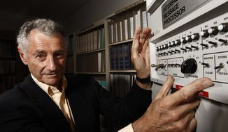 ** FILE ** In this Aug. 25, 2009, file photo, Internet pioneer Len Kleinrock poses for a portrait next to an Interface Message Processor, which was used to develop the Internet. Kleinrock, arguably the world's first Internet user, says Facebook is fine for his grandchildren, but it's not for him. (AP Photo/Matt Sayles, File)