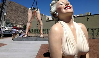 """""""Forever Marilyn,"""" the 26-foot-tall sculpture of the blonde Hollywood icon, is reassembled on Monday, May 14, 2012, at the corner of Palm Canyon Drive and Tahquitz Canyon Way in Palm Springs, Calif., the area slated to be a temporary park at the Desert Fashion Plaza site. (AP Photo/The Desert Sun, Marilyn Chung)"""