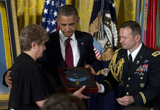 President Obama awards posthumously the Medal of Honor to Rose Mary Sabo-Brown, widow of Army Specialist Leslie H. Sabo Jr., during a ceremony May 16, 2012, at the White House. Sabo was killed in 1970 in Cambodia during the Vietnam War. (Associated Press)