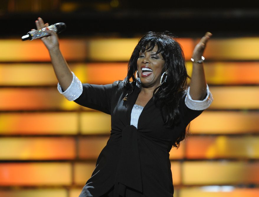 "**FILE** Donna Summer performs May 21, 2008, during the finale of ""American Idol"" at the Nokia Theatre in Los Angeles. (Associated Press)"