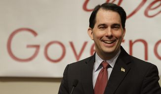 Wisconsin Gov. Scott Walker speaks to the Illinois Chamber of Commerce in Springfield, Ill., on Tuesday, April 17, 2012. (AP Photo/Seth Perlman)