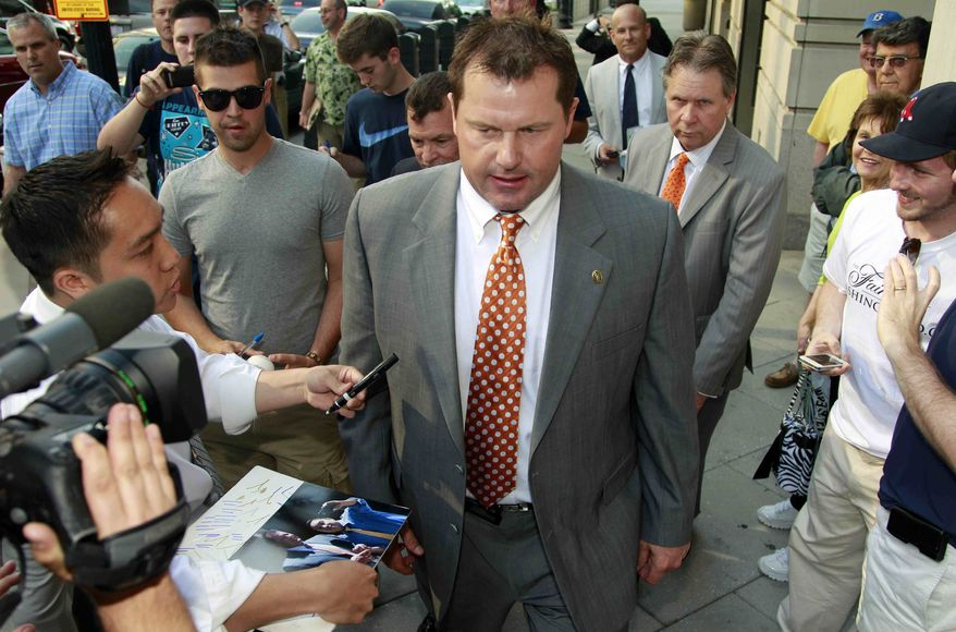 After signing autographs, former Major League Baseball pitcher Roger Clemens leaves federal court, Thursday, May 17, 2012, in Washington. (AP Photo/Haraz N. Ghanbari)
