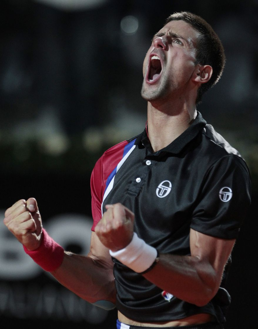 \Novak Djokovic celebrates after defeating Roger Federer in their semifinal match at the Italian Open in Rome on Saturday, May 19, 2012. (AP Photo/Gregorio Borgia)