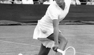 Althea Gibson competes at Wimbledon in England in 1956. She was among the more than a million black people who weren't counted in the 1940 census. The records were released April 2. (Associated Press)