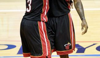 LeBron James (right) and Dwyane Wade scored 40 and 30 points, respectively, for Miami. James added 18 rebounds for the Heat, who head home for Game 5. (Associated Press)