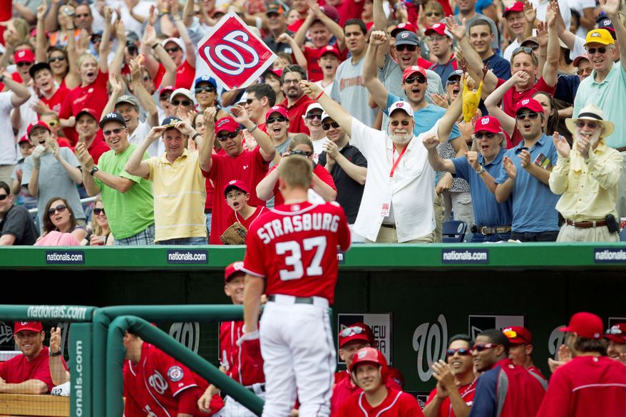 Nationals ace Stephen Strasburg acknowledges the crowd after hitting his first career home run during the fourth inning. Strasburg's blast sparked the Nationals to a 9-3 win after they fell behind 3-0 in the second inning. (Associated Press)