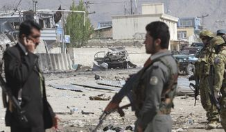 ** FILE ** Afghan security men and NATO soldiers (right) are seen at the scene of an attack by militants in Kabul, Afghanistan, on Wednesday, May 2, 2012. (AP Photo/Musadeq Sadeq)