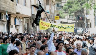 Syrians chant slogans during a demonstration in the Zabadani neighborhood of Damascus, Syria, on Friday, May 18, 2012. (AP Photo/Fadi Zaidan)