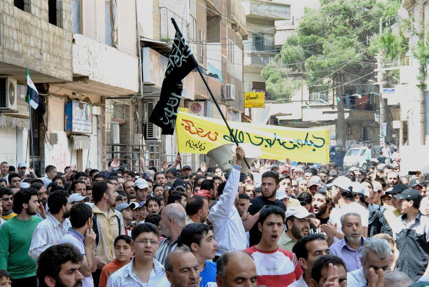 Syrians chant slogans during a demonstration in the Zabadani neighborhood of Damascus, Syria, on Friday, May 18, 2012. (AP Photo/Fadi Zaidan)