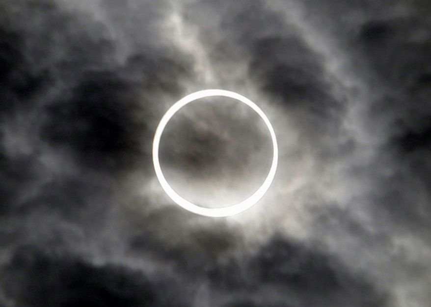 An annular solar eclipse is seen in the sky over Tokyo Monday, May 21, 2012.  (AP Photo/Toru Takahashi)