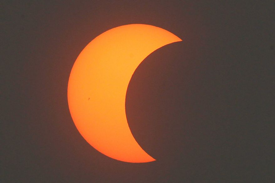 A partial annular solar eclipse is seen over Beijing, China, Monday, May 21, 2012.   (AP Photo/Ng Han Guan)