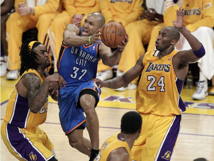 Oklahoma City Thunder's Derek Fisher, center, goes up for a basket against Los Angeles Lakers' Kobe Bryant, right, and Jordan Hill during the second half in Game 3 of an NBA playoffs Western Conference semifinal in Los Angeles, Friday, May 18, 2012. (AP Photo/Jae C. Hong)
