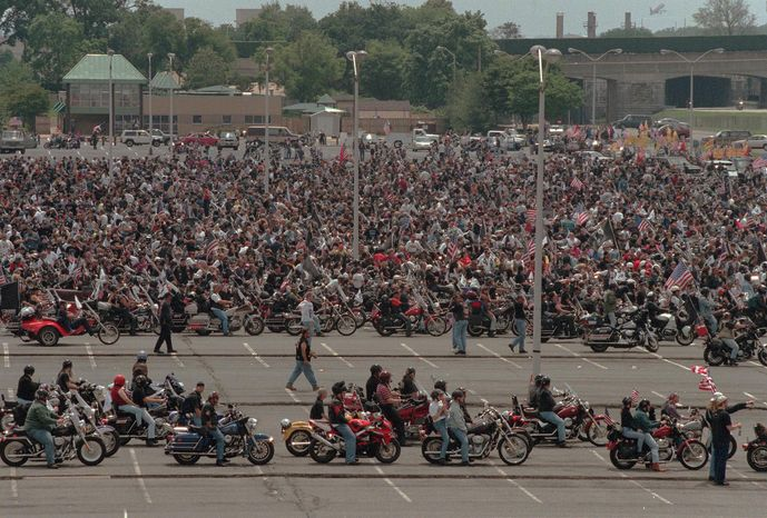 Motorcycle riders line up to participate in this year's Rolling Thunder parade, in the parking lot of the Pentagon on Sunday, May 27, 2001. ( Vance Jacobs / The Washington Times )