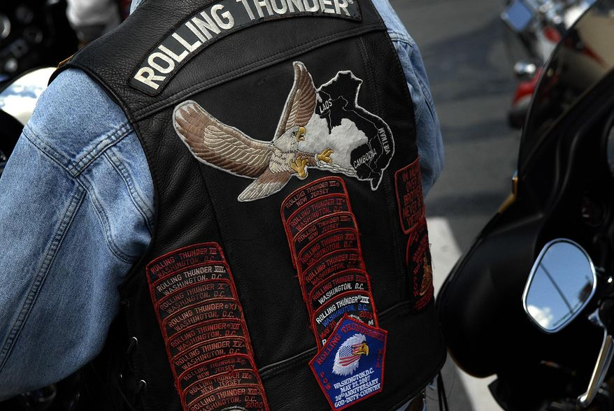 Steven Prager of East Brunswick, N.J., wears a vest with patches as he makes a pit stop with about 40 other riders from Rolling Thunder at the Maryland House along I-95 in Harford County, Md., Friday May 23, 2008. They are en route to the Vietnam Veteran's memorial in Washington D.C., this evening for a candle light vigil, and the Rolling Thunder event in Washington D.C., tomorrow Saturday May 24. (Rod Lamkey Jr./The Washington  Times)