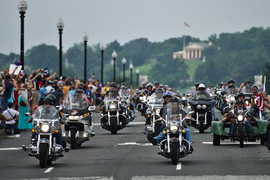 Participants in the Rolling Thunder annual motorcycle rally ride across Memorial Bridge near the National Mall during the Memorial Day weekend, in Washington, D.C., Sunday, May 29, 2011. The Rolling Thunder organization's mission is to bring awareness to the POW-MIA issue and to educate the public of the fact that many American prisoners of war were left behind after all past wars. (Drew Angerer/The Washington Times)