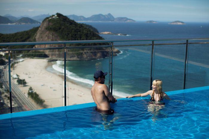 Tourists cool off at a hotel in Rio de Janeiro. The host city for the U.N.-sponsored Rio+20 conference is woefully lacking in accommodations for the green summit, with a total of 33,000 beds. Before cancellations, more than 50,000 diplomats and staffers were expected to come to Brazil for the June 20-22 summit. (Associated Press)