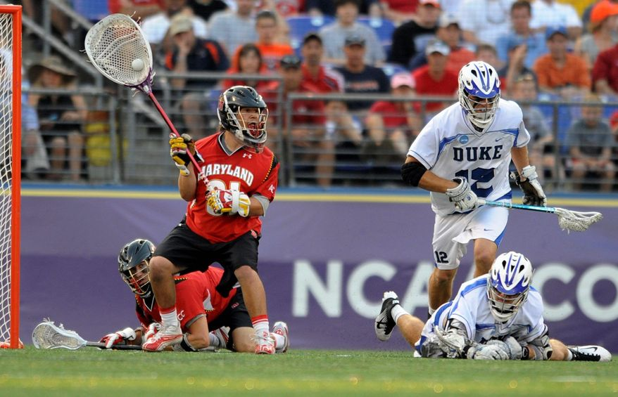 Maryland sophomore goalie Niko Amato (left), shown against Duke, came up with four big first-quarter saves Sunday in the Terrapins' 11-5 victory over Johns Hopkins. He'll face the Blue Devils again in the NCAA semifinals in Foxborough, Mass. (Associated Press)