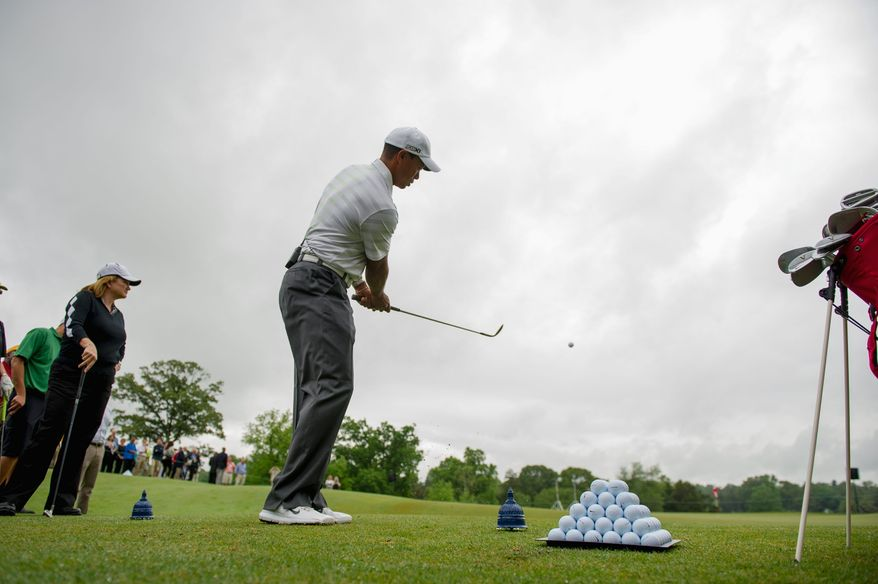 Tiger Woods holds a fan chipping contest leading up to the AT&T National at Congressional Country Club Bethesda. Woods is competing in the tournament - which starts June 26 - for the first time since 2009. (Andrew Harnik/The Washington Times)