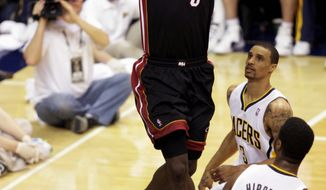 associated press Miami forward LeBron James elevates among a trio of Pacers to dunk for two of his 40 points in the Heat's 101-93 win in Game 4 on Sunday.