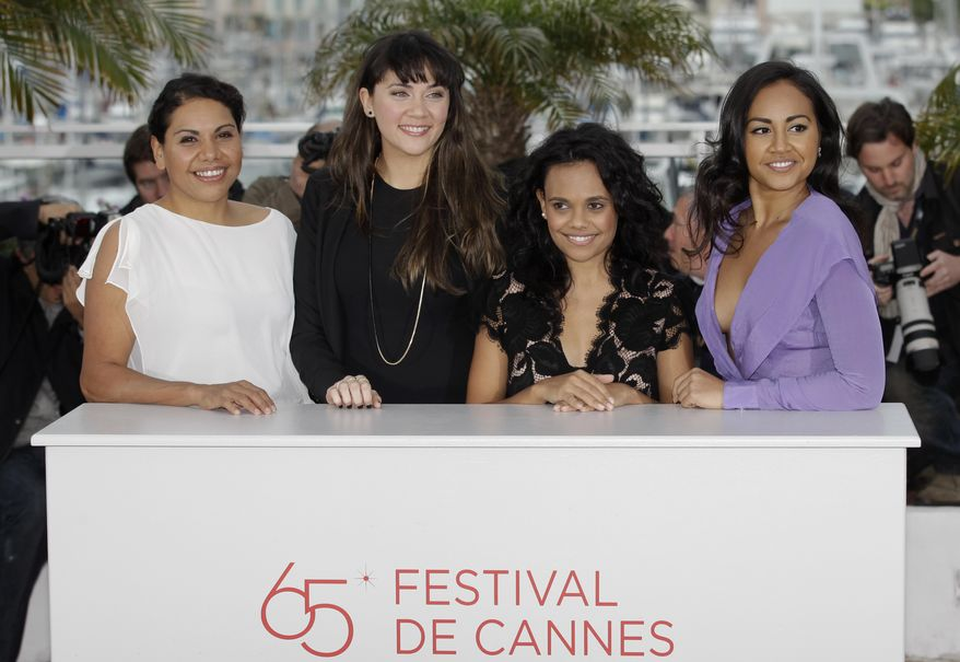 Actress Deborah Mailman, left, Shari Sebbens, Miranda Tapsell and Jessica Mauboy pose during a photo call for The Sapphires at the 65th international film festival, in Cannes, southern France, Sunday, May 20, 2012. (AP Photo/Lionel Cironneau)