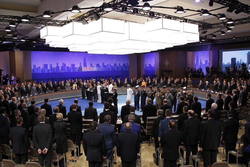 The NATO leaders gather May 20, 2012, as the opening session of the NATO Summit begins in Chicago. (Associated Press)