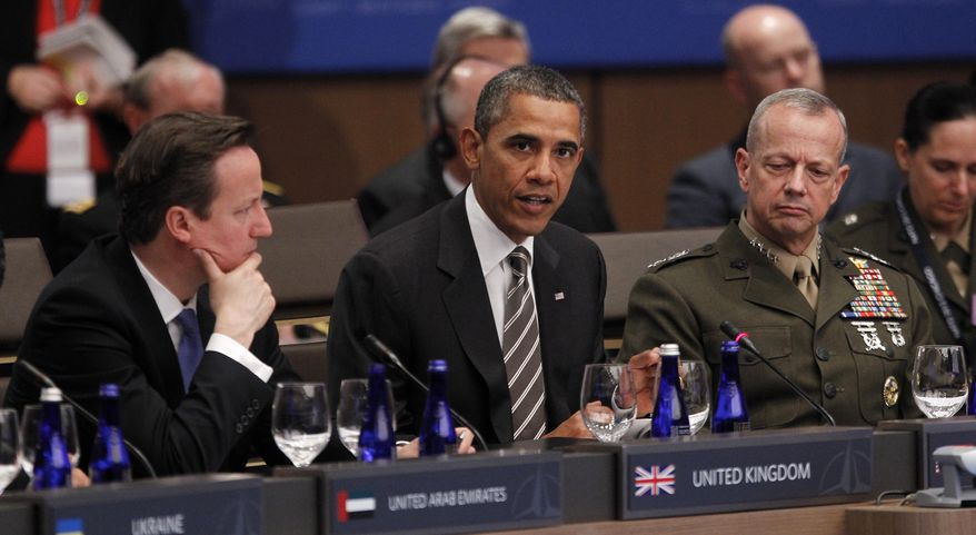President Obama (center) speaks at the start of the International Security Assistance Force (ISAF) meeting on Afghanistan at the NATO Summit in Chicago on May 21, 2012. From left are British Prime Minister David Cameron, Obama and Gen. John R. Allen, Commander of the International Security Assistance Force. (Associated Press)