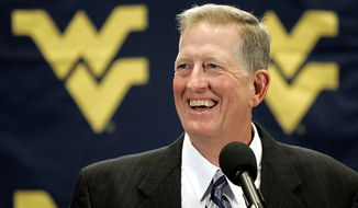 ** FILE ** In this photo taken Jan. 3, 2008, Bill Stewart talks to reporters in Scottsdale, Ariz., after being named West Virginia football coach. The former coach died Monday, May 21, 2012, of what athletic department officials said was an apparent heart attack. Stewart, 59, resigned last summer. Stewart had gone 28-12 in three seasons. (AP Photo/Matt York, File)
