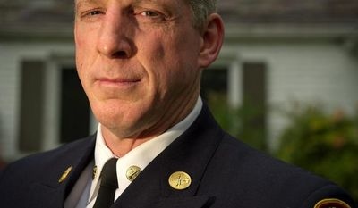 """Battalion Fire Chief Kevin B. Sloan said he received no written explanation for his transfer to a desk job where he is in charge of overseeing use of supplies in fire stations. """"It's not ethical, it's not moral. It's retaliatory action,"""" he said. (Rod Lamkey Jr./The Washington Times)"""