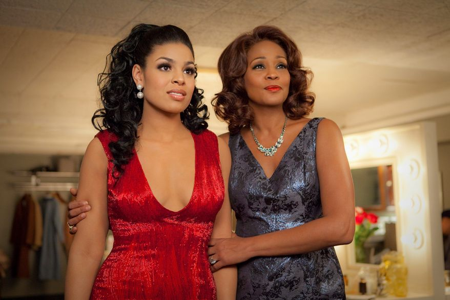"""The duet of """"Celebrate"""" from the movie """"Sparkle"""" with Jordin Sparks (left) and Whitney Houston - Houston's final recording - will be available June 5 on iTunes. (Sony Pictures Entertainment via Associated Press)"""