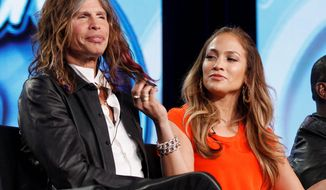 """""""American Idol"""" judge Jennifer Lopez plays with the hair of fellow judge Steven Tyler of Aerosmith. Mr. Tyler is mum on whether he or Jennifer Lopez will return to the judging panel on """"American Idol"""" next year, but the rocker says he has loved the experience of sitting next to her. """"She's a sexy beast,"""" Mr. Tyler said on Monday. """"I feed off that female energy with her."""" (Associated Press)"""